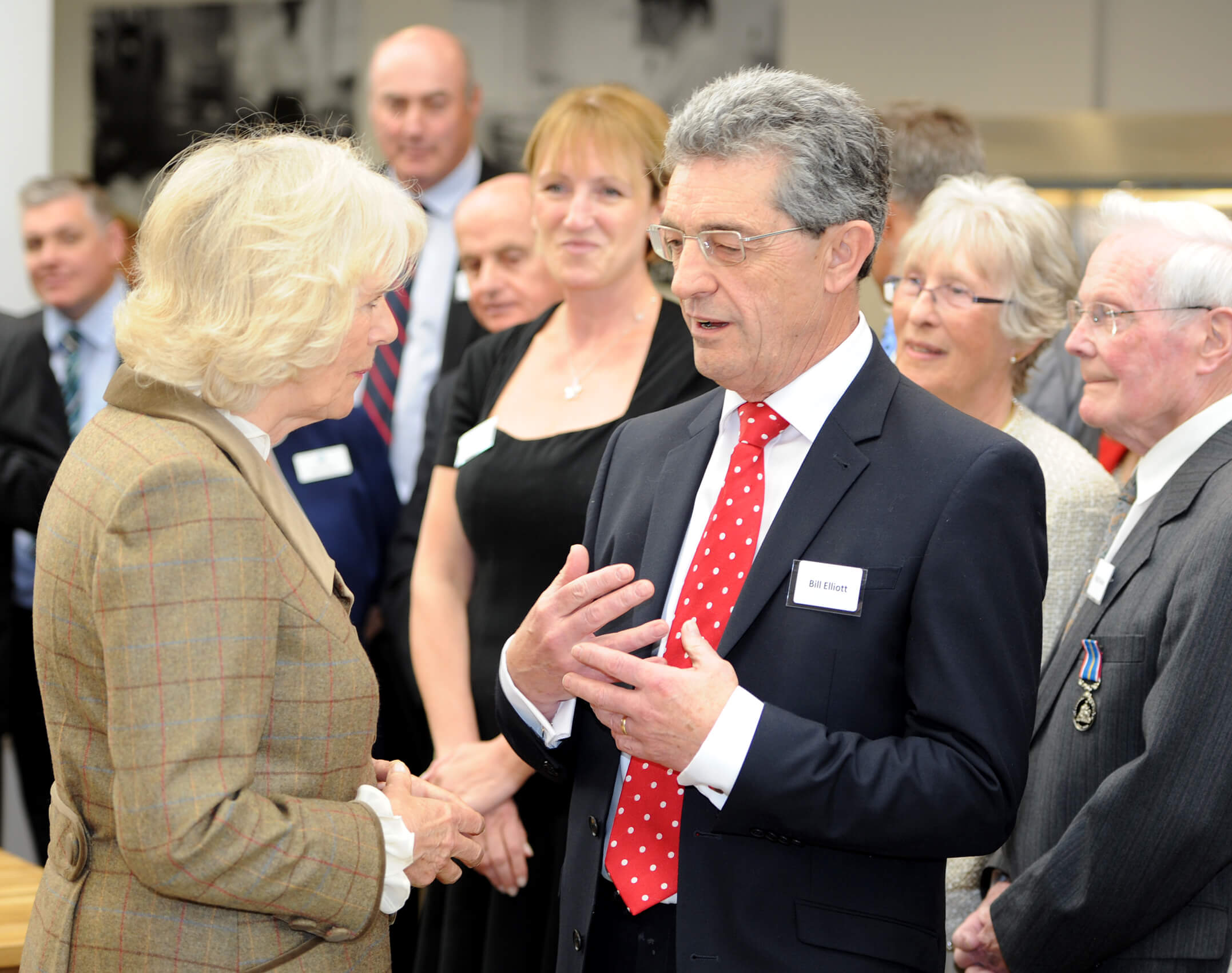 Photo of Bill Elliott being presented to HRH Duchess of Cornwall