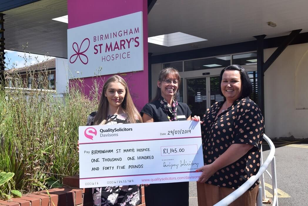 QualitySolicitors Davisons Private Client Legal Executive, Tracey Salt and Assistant, Libby Carr present a £1,145 cheque to Birmingham St Mary's Hospice Legacy Manager, Katy O'Sullivan