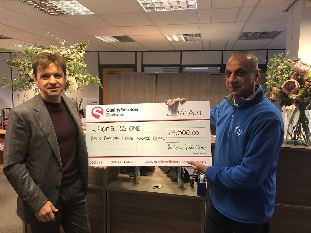 QualitySolicitors Davisons Managing Director Gary Davison presents a cheque for £4,500 to HomeLess One representative Moe Nawaz