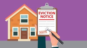 Eviction notice held up in front of house